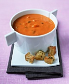 Cream of tomato soup with herb croutons