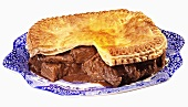 Beef pie, a portion taken