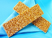 Two sesame bars on blue paper napkin