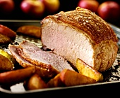 Roast pork with apples, partly carved