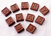 Chocolate squares with letters spelling 'Merry Xmas'