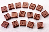 Chocolate squares with letters spelling 'Happy Birthday'