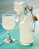 Traditional English ginger beer in glass and bottle