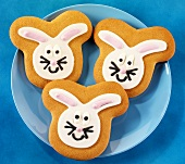 Three Easter Bunny biscuits on blue plate