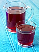 Cranberry juice in glass and jug