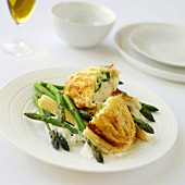 Chicken breast in pastry with asparagus and baby corn cobs