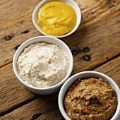 Creamed horseradish & two sorts of mustard in small dishes