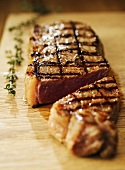 Grilled sirloin steak, cut into two pieces