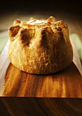 Pork pie on chopping board (UK)