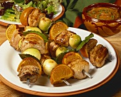 Pork and mandarin kebabs with onions