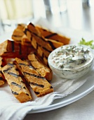 Grilled sweet potato sticks with a dip