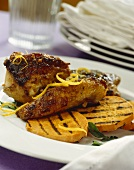 Roasted guinea fowl with grilled sweet potato slices