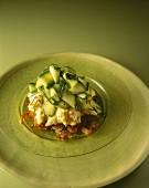Scrambled egg with smoked salmon and courgette slices on Rösti (fried Swiss potato cakes)