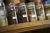 Various types of barley malt in jars