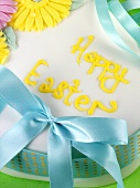 Easter cake with flower decoration and bow
