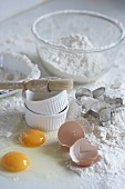 Still life with flour, eggs and ramekins