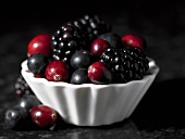 Cranberries, blueberries and blackberries in a small dish