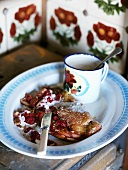 Berry pancake with a mug of hot milk