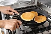 Frying pancakes in a frying pan