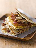 Bacon, egg and mushrooms in flatbread