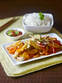 Sweet and sour chicken with cashew nuts and rice (Asia)