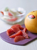 Grapefruit segments and whole grapefruit