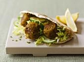 Falafel sandwich (Chick-pea balls in pita bread)