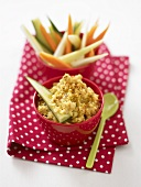 Hummus and raw vegetable sticks on spotted napkin