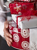 Woman holding a pile of Christmas gifts