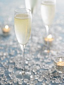 Several glasses of champagne, candles and crystals