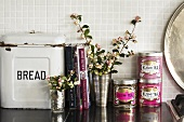 Bread and tea tins, books