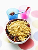 A bowl of berry crumble