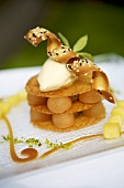 Poached apple with vanilla ice cream and wafers