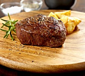 Beef fillet steak with potato wedges and rosemary