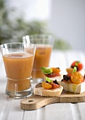 Tomato crostini and two fruit cocktails