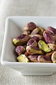 Shelled pistachios in a dish