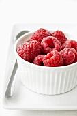 Fresh raspberries in a ramekin