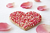 Heart-shaped biscuit with rose petals