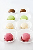 Coloured macarons in paper cases