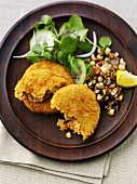 Breaded fish cakes with chick-pea salad