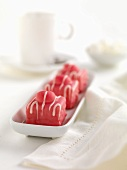 Three petit fours with raspberry icing