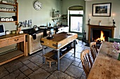 Kitchen with chopping block, dining table and open fire
