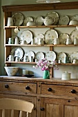 Wooden dresser with crockery