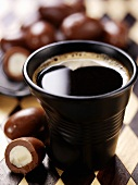 Cup of coffee with chocolate Brazil nuts