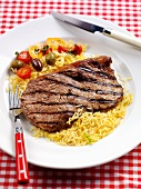 Grilled beefsteak with rice and vegetables