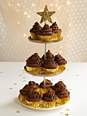 Chocolate cupcakes on tiered stand (Christmas)