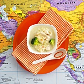Chicken soup with broccoli on map (Thailand)
