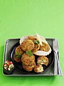 Crab cakes on black plate