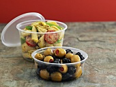 Pasta salad and marinated olives to take away