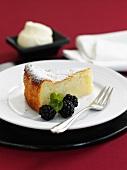 Piece of lemon cheesecake with fresh blackberries